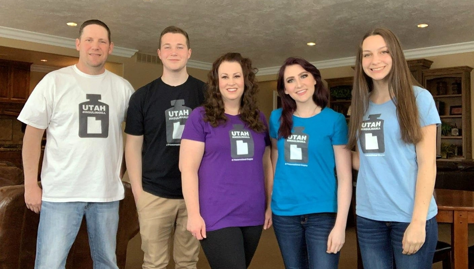 Mindie Hooley and her family stand together in their Utah insulin4all t-shirts